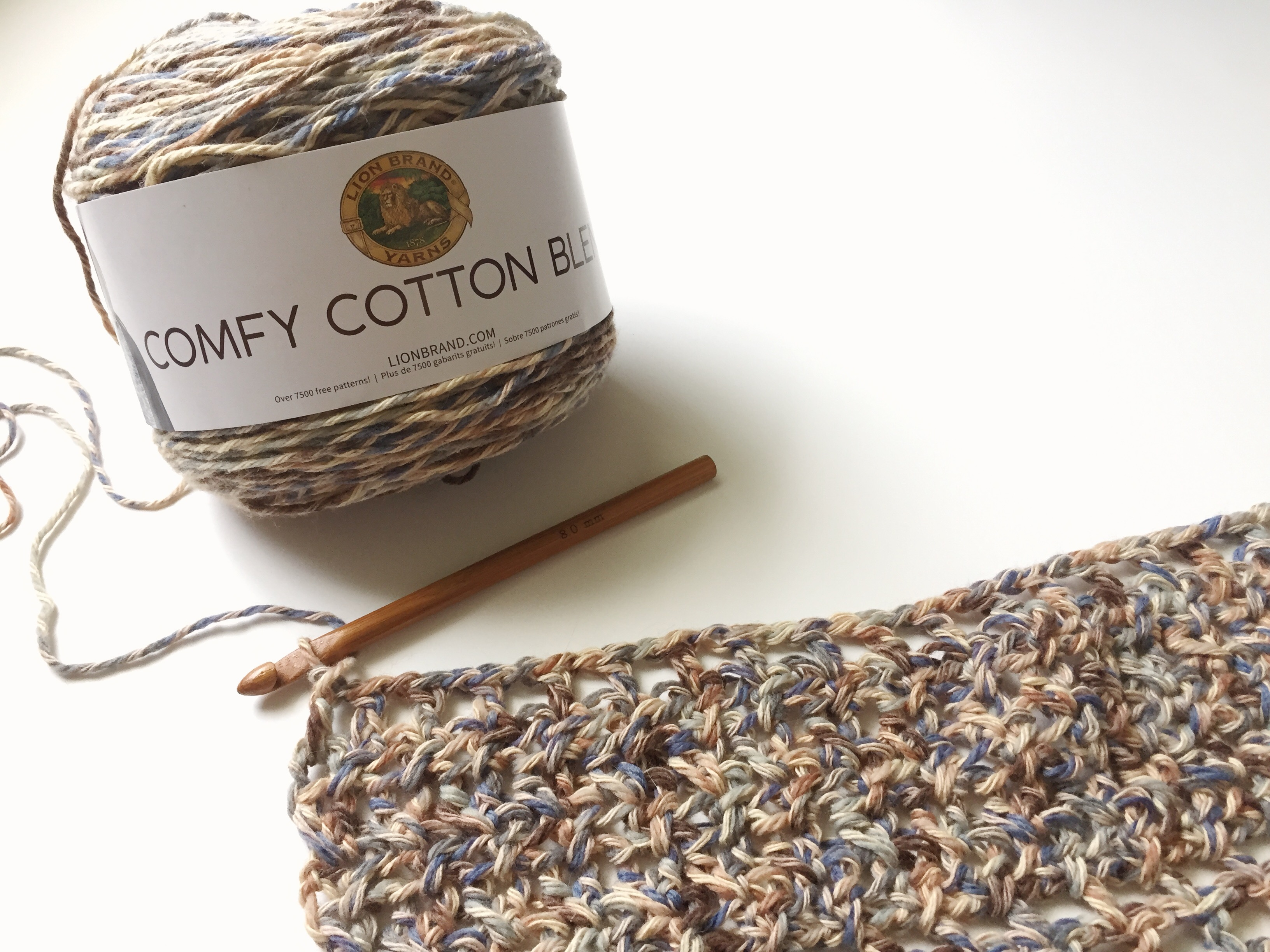 "Lion Brand Yarn's Comfy Cotton Blend in 'Driftwood"" with a crochet sample."